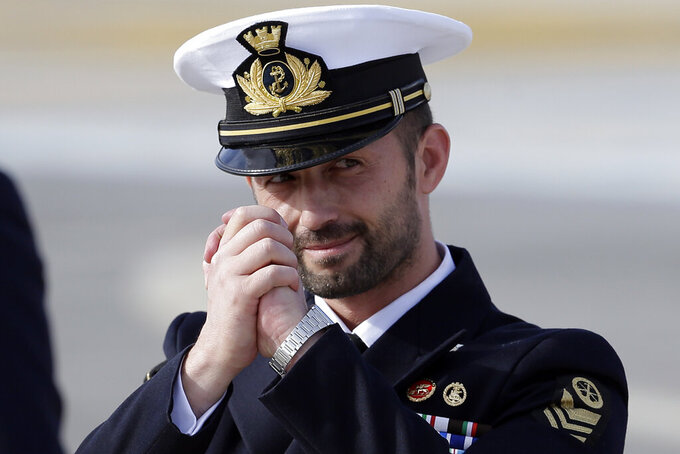 FILE - In this May 28, 2016, file photo, Italian Marine Salvatore Girone greets the journalists as he arrives at Rome's Ciampino airport. India's Supreme Court on Tuesday, June 15, 2021, closed criminal proceedings against two Italian marines, Girone and Massimiliano Latorre in the shooting deaths of two Indian fisherman in 2012 after Italy paid 1.1 million euros in damages, ending one chapter in a long-simmering case that has strained relations between the two countries. (AP Photo/Gregorio Borgia, File)