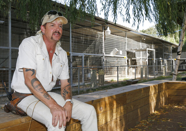 """FILE - In this Aug. 28, 2013, file photo, the late Joseph Maldonado-Passage, also known as Joe Exotic,  answers a question during an interview at the zoo he runs in Wynnewood, Okla. The Oklahoma zoo, featured in Netflix's """"Tiger King"""" documentary, has closed after federal authorities investigated it for alleged maltreatment of animals and suspended its license. The Greater Wynnewood Exotic Animal Park closed to the public after the U.S. Department of Agriculture on Monday, Aug. 17, 2020, suspended the exhibitor license for current-owner Jeff Lowe for 21 days.(AP Photo/Sue Ogrocki, File)"""