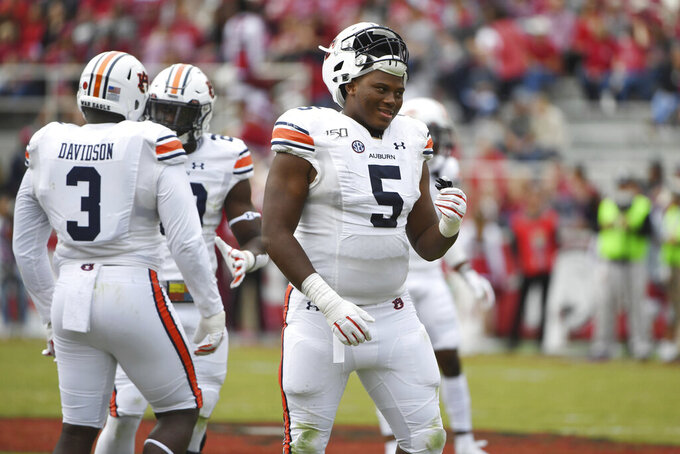 FILE - In this Oct. 19, 2019, Auburn defender Derrick Brown (5) plays against Arkansas during an NCAA college football game, in Fayetteville, Ark. Brown was selected to The Associated Press All-America team, Monday, Dec. 16, 2019. (AP Photo/Michael Woods, File)