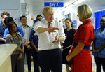 Britain's Prime Minister Boris Johnson speaks to health professionals as he visits Watford General hospital, England, Monday Oct. 7, 2019. The UK government has pledged billions for new hospital projects across England under plans devised up by Health Secretary Matt Hancock. (Peter Summers/Pool via AP)