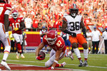 Kansas City Chiefs tight end Travis Kelce (87) scores past Cleveland Browns safety M.J. Stewart Jr. (36) during the second half of an NFL football game Sunday, Sept. 12, 2021, in Kansas City, Mo. (AP Photo/Ed Zurga)