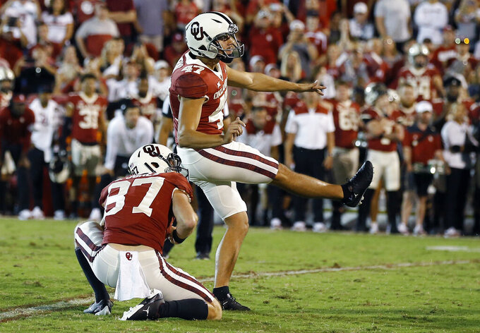 Oklahoma place kicker Gabe Brkic (47) watches as his game winning field goal against West Virginia goes through the goal post during the second half of an NCAA college football game in Norman, Okla., Saturday, Sep. 25, 2021. (AP Photo/Alonzo Adams)