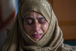 """Rafiqa Banoo, mother of 16-year-old Athar Mushtaq, breaks down while talking to Associated Press in Bellow, south of Srinagar, Indian controlled Kashmir, Tuesday, Jan. 5, 2021. On the last week of 2020, Indian government forces killed Athar and two other young men during a controversial gunfight on the outskirts of the Indian-controlled Kashmir's main city. Police did not call them anti-India militants but """"hardcore associates of terrorists."""
