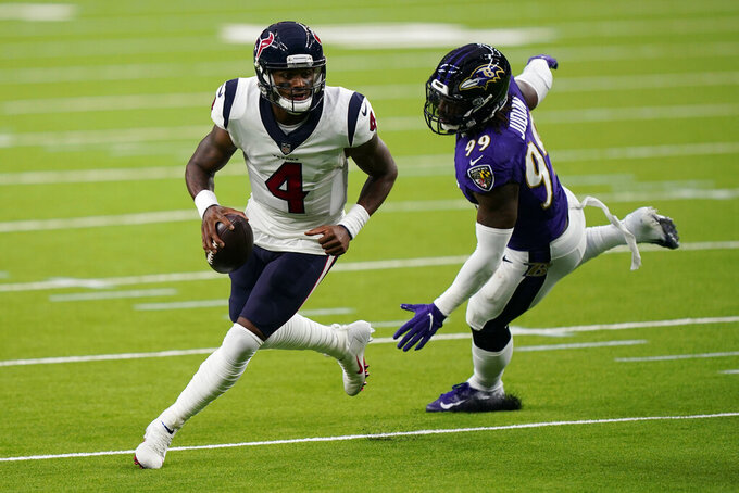 Houston Texans quarterback Deshaun Watson (4) scrambles a Baltimore Ravens outside linebacker Matt Judon (99) pressures him during the first half of an NFL football game Sunday, Sept.20, 2020, in Houston. (AP Photo/David J. Phillip)