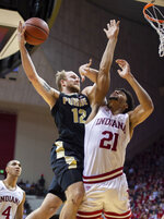 Purdue forward Evan Boudreaux (12) drives the ball into the defense of Indiana forward Jerome Hunter (21) at the goal during the second half of an NCAA college basketball game, Saturday, Feb. 8, 2020, in Bloomington, Ind. Purdue won 74-62. (AP Photo/Doug McSchooler)