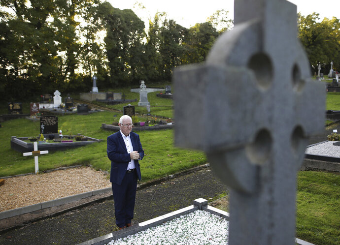 In this photo taken on Wednesday Oct. 16, 2019, Eugene Reavey visits the graves of his three brothers in Whitecross in South Armagh, Northern Ireland. Peace is personal for Reavey. He lost three brothers to the conflict in Northern Ireland, which claimed more than 3,500 lives over three decades. (Photo/Peter Morrison)