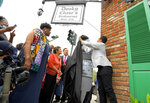 Artist Ernest M. English unveils an historical marker outside of Dooky Chase's Restaurant on Orleans Avenue that honors significant locations in the Civil Rights movement in New Orleans, Monday, May 3, 2021. Dooky Chase's Restaurant was honored because it was a common meeting point for leaders of the Civil Rights movement during the era of segregation. The Louisiana Civil Rights Trail markers project will eventually include 15 locations. (Max Becherer/The Times-Picayune/The New Orleans Advocate via AP)