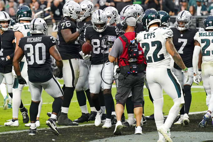 Las Vegas Raiders wide receiver Bryan Edwards (89) holds the ball after scoring a touchdown against the Philadelphia Eagles during the second half of an NFL football game, Sunday, Oct. 24, 2021, in Las Vegas. (AP Photo/Rick Scuteri)