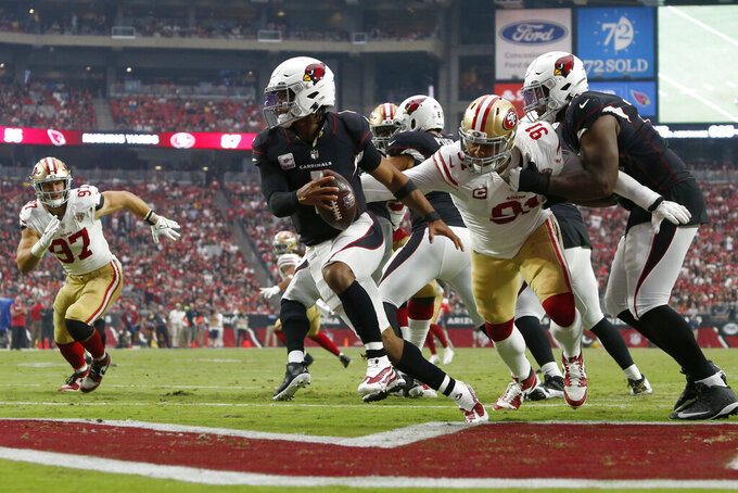 Arizona Cardinals quarterback Kyler Murray (1) eludes the reach of San Francisco 49ers defensive end Arik Armstead (91) during the second half of an NFL football game, Sunday, Oct. 10, 2021, in Glendale, Ariz. (AP Photo/Ralph Freso)