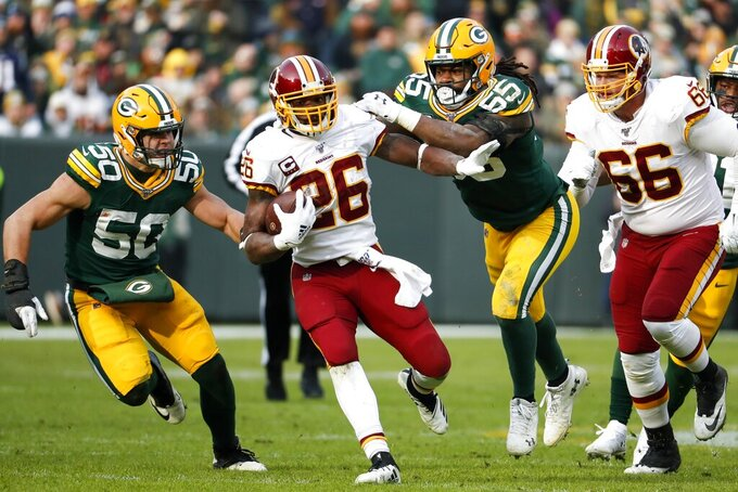Washington Redskins' Adrian Peterson runs during the first half of an NFL football game against the Green Bay Packers Sunday, Dec. 8, 2019, in Green Bay, Wis. (AP Photo/Matt Ludtke)