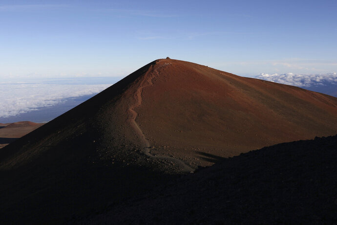 FILE - This July 14, 2019, file photo shows the summit of Hawaii's Mauna Kea. For activists who say they're protecting Mauna Kea, the fight against the proposed Thirty Meter Telescope is a boiling point in Hawaiian history: the overthrow on the Hawaiian kingdom, battles over land, water and development and questions about how the islands should be governed. (AP Photo/Caleb Jones, File)