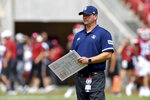 Rice coach Mike Bloomgren watches his team get ready to play Arkansas in an NCAA college football game Saturday, Sept. 4, 2021, in Fayetteville, Ark. (AP Photo/Michael Woods)