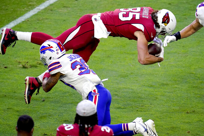 Arizona Cardinals tight end Dan Arnold (85) is up-ended by Buffalo Bills cornerback Dane Jackson (30) during the first half of an NFL football game, Sunday, Nov. 15, 2020, in Glendale, Ariz. (AP Photo/Ross D. Franklin)