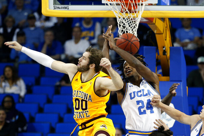Arizona State forward Mickey Mitchell (00) and UCLA forward Jalen Hill (24) vie for a rebound during the first half of an NCAA college basketball game Thursday, Feb. 27, 2020, in Los Angeles. (AP Photo/Ringo H.W. Chiu)