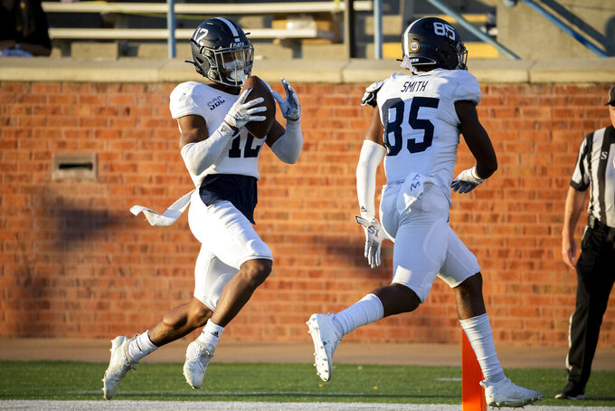 Georgia Southern running back Wesley Kennedy III (12) carries the ball over the goal line for a touchdown during the second half of an NCAA football game against Massachusetts, Saturday, Oct. 17, 2020, in Statesboro, Ga. (AP Photo/Stephen B. Morton)