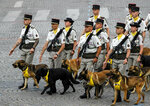 Soldiers of the 132 infantry march on the Champs-Elysees avenue during the Bastille Day parade in Paris, France, Sunday July 14, 2019. (AP Photo/Michel Euler)