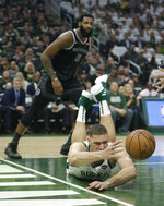 Milwaukee Bucks' Brook Lopez is unable to save the ball from going out of bounds in front of Detroit Pistons' Andre Drummond during the first half of Game 1 of an NBA basketball first-round playoff series Sunday, April 14, 2019, in Milwaukee. (AP Photo/Aaron Gash)