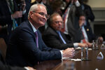 Exxon Mobil CEO Darren Woods listens as President Donald Trump speaks during a meeting with energy sector business leaders in the Cabinet Room of the White House, Friday, April 3, 2020, in Washington. (AP Photo/Evan Vucci)