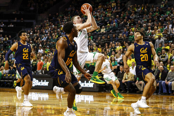 Oregon guard Payton Pritchard (3) shoots against California during the first half during an NCAA college basketball game in Eugene, Ore., Thursday, March 5, 2020. (AP Photo/Thomas Boyd)