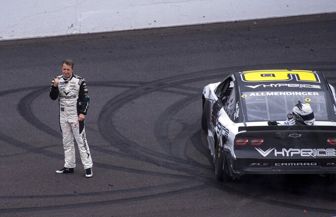 AJ Allmendinger reacts at the finish line after winning a NASCAR Cup Series auto race at Indianapolis Motor Speedway, Sunday, Aug. 15, 2021, in Indianapolis. (AP Photo/Doug McSchooler)
