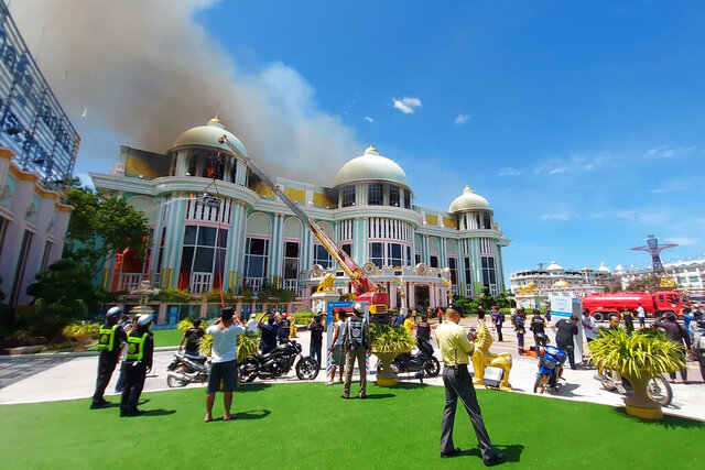 Firefighters attempt to put out a fire of a gaudy mansion in a Buddhist-themed tourist park in Pattaya, Thailand, Wednesday, July 1, 2020. The mansion in Thailand's seaside resort city of Pattaya was seriously damaged by the fire Wednesday that sent thick black smoke billowing into the sky. No one was injured in the blaze. (AP Photo/Amporn Sangkaew)