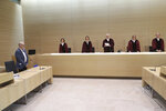 Presiding Judge at the Federal Court of Justice Stephan Seiters center, announced the verdict in the trial between the Volkswagen company and the owner of a VW Diesel passenger car Herbert Gilbert, left,  in Karlsruhe, Germany, Monday, May 25, 2020. According to the ruling, Volkswagen is basically obliged to pay damages to car owners affected by the diesel scandal. (Thorsten Gutschalk/Pool/dpa via AP)