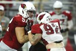Arizona Cardinals center Mason Cole (52) puts a block on Cardinals linebacker Dennis Gardeck (92) during an NFL football training camp practice at State Farm Stadium Tuesday, Aug. 6, 2019, in Glendale, Ariz. (AP Photo/Ross D. Franklin)