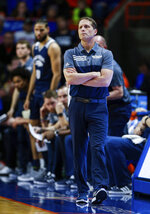 Nevada head coach Eric Musselman walks the sideline during the first half of an NCAA college basketball game against Boise State, Tuesday, Jan. 15, 2019, in Boise, Idaho. (AP Photo/Steve Conner)