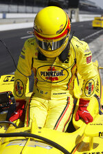 Helio Castroneves, of Brazil, climbs out of his car during practice for the Indianapolis 500 IndyCar auto race at Indianapolis Motor Speedway, Tuesday, May 14, 2019, in Indianapolis. (AP Photo/Darron Cummings)