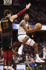 New York Knicks' Elfrid Payton (6) drives to the basket against Cleveland Cavaliers' Cedi Osman (16) in the second half of an NBA basketball game, Monday, Jan. 20, 2020, in Cleveland. New York won 106-86. (AP Photo/Tony Dejak)