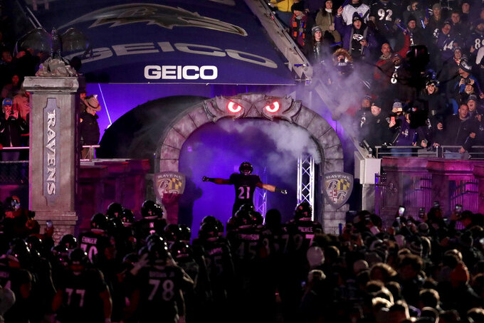 Baltimore Ravens running back Mark Ingram (21) is introduced onto the field prior to an NFL football game against the New York Jets, Thursday, Dec. 12, 2019, in Baltimore. (AP Photo/Julio Cortez)