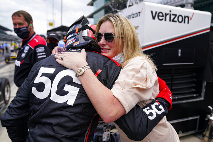 Will Power of Australia celebrates with his wife Elizabeth  after he made the field during the last row qualifications for the Indianapolis 500 auto race at Indianapolis Motor Speedway in Indianapolis, Sunday, May 23, 2021. (AP Photo/Michael Conroy)