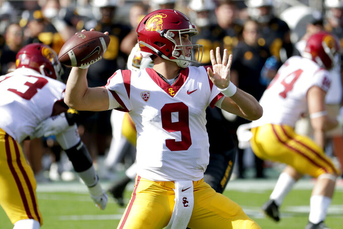 Southern California quarterback Kedon Slovis (9) throws the ball against Arizona State during the first half of an NCAA college football game, Saturday, Nov. 9, 2019, in Tempe, Ariz. (AP Photo/Matt York)