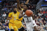 Missouri State's Keandre Cook (1) passes around Valparaiso's Mileek McMillan and Eron Gordon, left, during the second half of an NCAA college basketball game in the semifinal round of the Missouri Valley Conference men's tournament Saturday, March 7, 2020, in St. Louis. (AP Photo/Jeff Roberson)