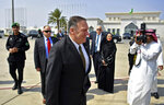 U.S. Secretary of State Mike Pompeo walks from his plane after arriving at al-Bateen Air Base in Abu Dhabi, United Arab Emirates, Thursday, Sept. 19, 2019. (Mandel Ngan/Pool via AP)