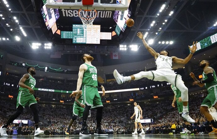 Milwaukee Bucks' Giannis Antetokounmpo shoots during the first half of Game 2 of a second round NBA basketball playoff series against the Boston Celtics Tuesday, April 30, 2019, in Milwaukee. (AP Photo/Morry Gash)