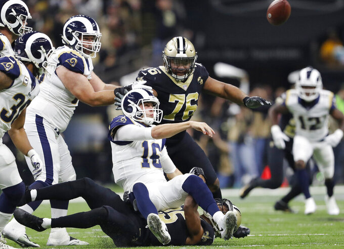 Los Angeles Rams' Jared Goff throws as he is taken down during the first half of the NFL football NFC championship game against the New Orleans Saints, Sunday, Jan. 20, 2019, in New Orleans. (AP Photo/John Bazemore)