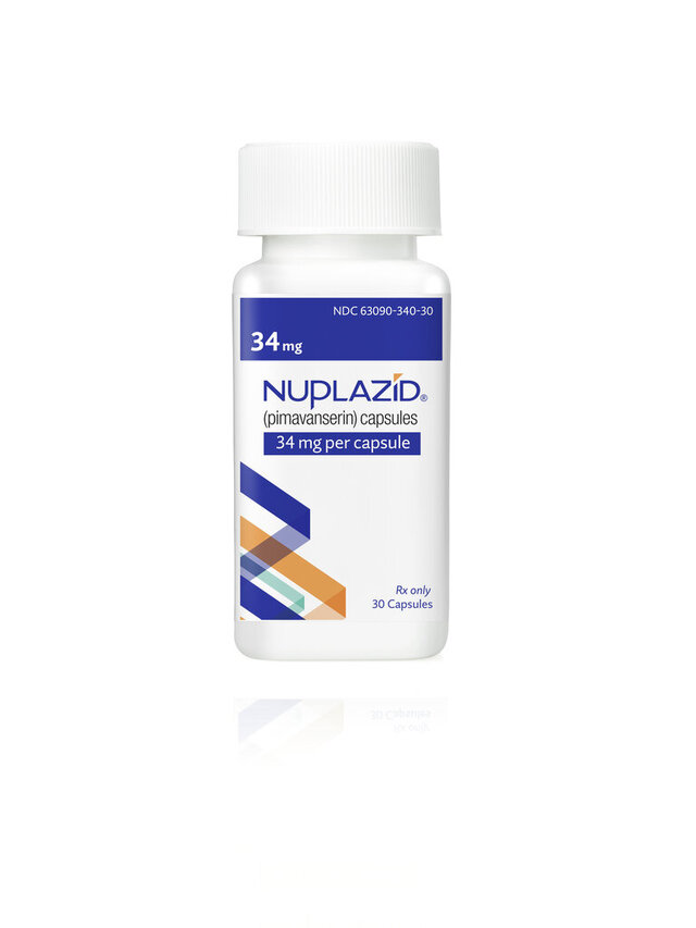 This undated photo provided by Acadia Pharmaceuticals Inc. shows a bottle of Nuplazid, a drug that was tested for treating psychosis related to dementia. If regulators agree, the drug could become the first treatment specifically for dementia-related psychosis and the first new medicine for Alzheimer's in nearly two decades. Results from a study on the drug were disclosed Wednesday, Dec. 4, 2019, at an Alzheimer's conference in San Diego.  (Acadia Pharmaceuticals Inc. via AP)