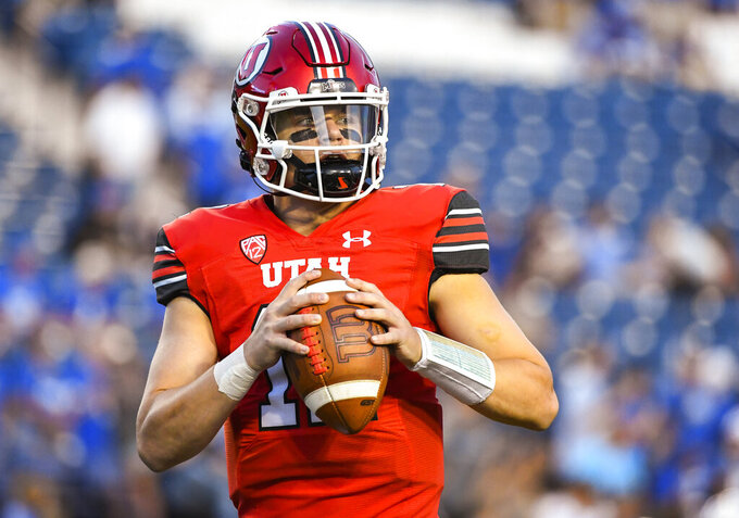 Utah quarterback Charlie Brewer warms up before a NCAA college football game against Brigham Young Saturday, Sept. 11, 2021, in Provo, Utah. (AP Photo/Alex Goodlett)