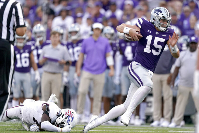 Kansas State quarterback Will Howard (15) gets past Southern Illinois cornerback James Ceasar (2) to run the ball during the first half of an NCAA college football game, Saturday, Sept. 11, 2021, in Manhattan, Kan.(AP Photo/Charlie Riedel)