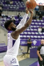 TCU guard Mike Miles shoots a 3-pointer during the second half of the team's NCAA college basketball game against Northwestern State in Fort Worth, Texas, Thursday, Dec. 3, 2020. (AP Photo/Tony Gutierrez)
