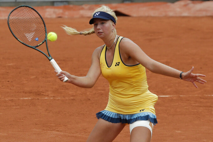 Denmark's Clara Tauson plays a shot against Jennifer Brady of the U.S. in the first round match of the French Open tennis tournament at the Roland Garros stadium in Paris, France, Tuesday, Sept. 29, 2020. (AP Photo/Alessandra Tarantino)