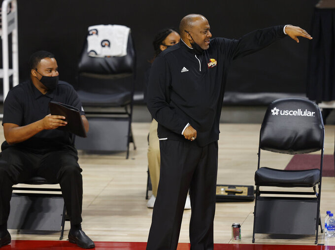 Arkansas-Pine Bluff head coach George Ivory, center, directs his team against Iowa State during the first half half of an NCAA college basketball game, Sunday, Nov. 29, 2020, in Ames, Iowa. (AP Photo/Matthew Putney)
