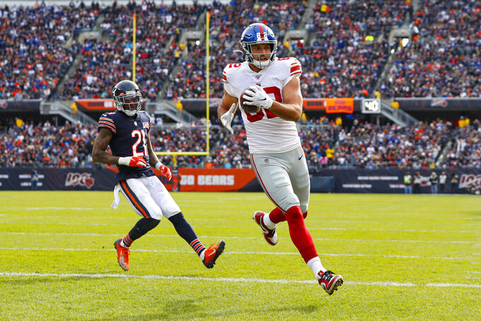New York Giants tight end Kaden Smith (82) runs in for a touchdown in front of Chicago Bears strong safety Ha Ha Clinton-Dix (21) during the first half of an NFL football game in Chicago, Sunday, Nov. 24, 2019. (AP Photo/Paul Sancya)