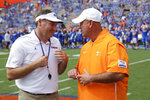 Florida head coach Dan Mullen, left, and Tennessee head coach Jeremy Pruitt greet each other on the field prior to an NCAA college football game, Saturday, Sept. 21, 2019, in Gainesville, Fla. (AP Photo/John Raoux)