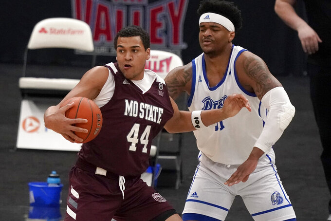 Missouri State's Gaige Prim (44) looks to pass as Drake's Darnell Brodie defends during the first half of an NCAA college basketball game in the semifinal round of the Missouri Valley Conference men's tournament Saturday, March 6, 2021, in St. Louis. (AP Photo/Jeff Roberson)