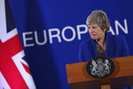 In this Thursday, April 11, 2019 file photo, British Prime Minister Theresa May speaks during a media conference at the conclusion of an EU summit in Brussels. As May announced her departure with a Brexit plan nowhere near success, European Union leaders offered kind words. But it was quite another matter during the years of negotiations with the bloc that often produced exasperation, miscommunication and even some ridicule of her. (AP Photo/Francisco Seco, File)