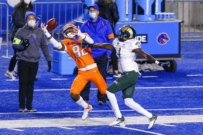 Boise State wide receiver Stefan Cobbs (82) reaches for a pass next to Colorado State defensive back Rashad Ajayi (4) during the first half of an NCAA college football game Thursday, Nov. 12, 2020, in Boise, Idaho. (AP Photo/Steve Conner)