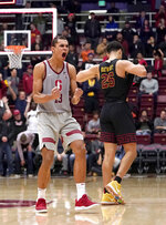 Stanford forward Oscar da Silva (13) celebrates following the team's 79-76 victory over Southern California in an NCAA college basketball game Wednesday, Feb. 13, 2019, in Stanford, Calif. (AP Photo/Tony Avelar)
