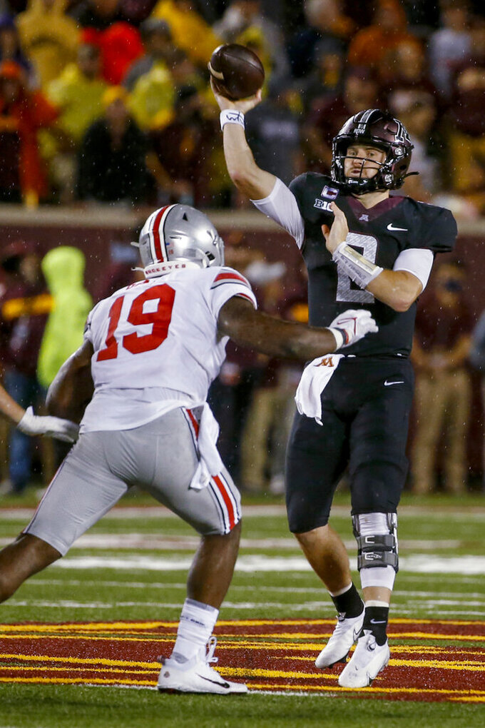 Minnesota quarterback Tanner Morgan (2) throws a pass as Ohio State linebacker Dallas Gant (19) rushes during the third quarter of an NCAA college football game Thursday, Sept. 2, 2021, in Minneapolis. Ohio State won 45-31. (AP Photo/Bruce Kluckhohn)